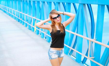 fashionable sunglasses: Portrait of a beautiful fashionable girl in sunglasses Stock Photo