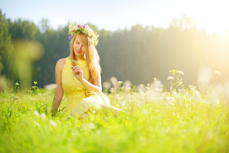 Pretty smiling girl relaxing on green meadow photo