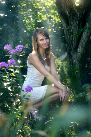 wood nymph: beautiful girl in fairy forest. light background Stock Photo