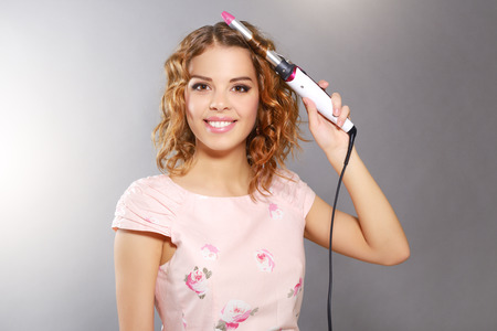 Hair curling  Young girl with curly hair photo