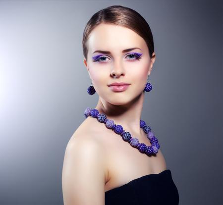 Girl with beautiful make-up on dark background photo