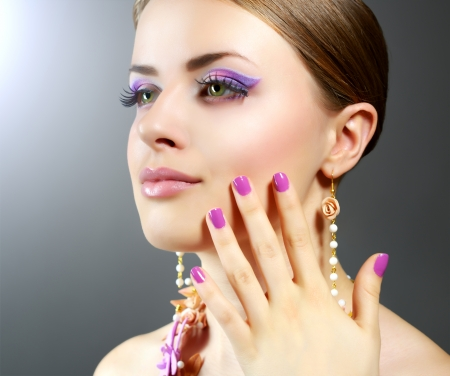 Girl with beautiful make-up on dark background