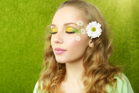 make up eyes: Girl with beautiful make-up on a green