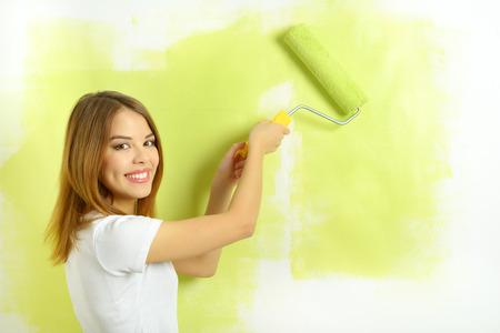 Beautiful girl painting a wall Stock Photo - 26039039