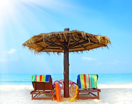 Beach chairs with umbrella.  Koh Chang, Thailand