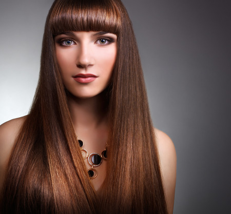 straight hair: Girl with straight hair on gray background Stock Photo
