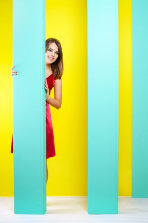 Fashionable girl in a red dress. abstract background photo