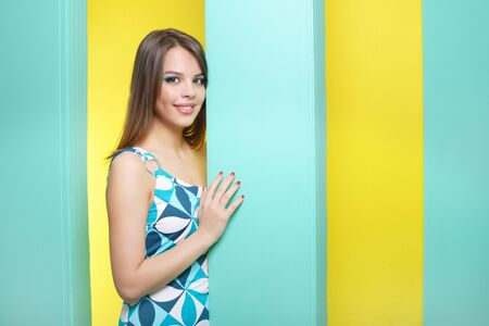 Fashionable girl in a short dress. abstract background photo