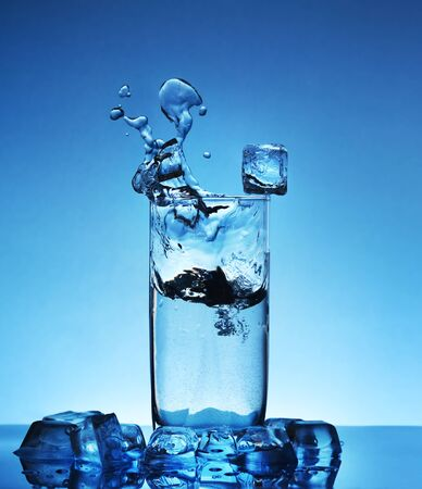 ice water: Ice water. Dark blue background Stock Photo