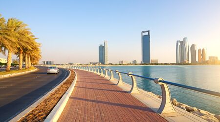 city road: Abu Dhabi, Corniche Road. Evening Stock Photo