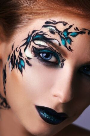 black makeup: Beautiful face of a woman with creative make-up Stock Photo