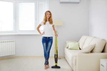vacuum cleaner: Girl with wireless vacuum cleaner