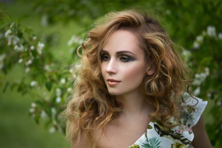 Girl with a beautiful make-up. Outdoors photo