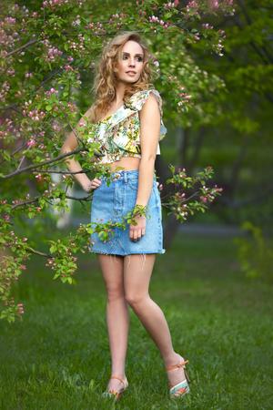 Summer portrait. Beautiful girl outdoors photo