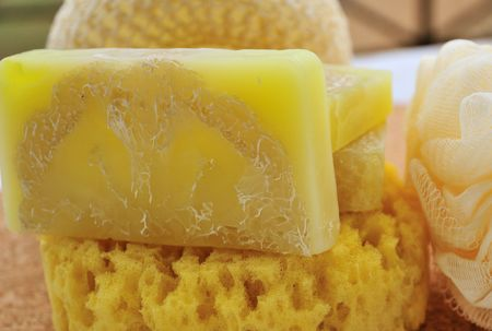 handmade soap: yellow hand-made soap and three bast wisps, element of spa