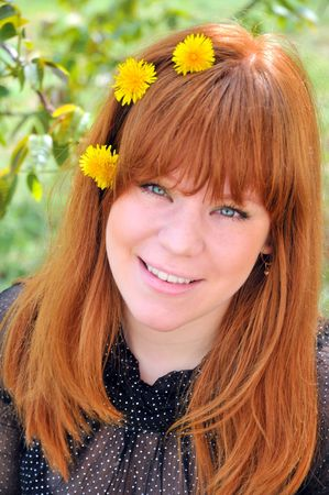redheaded: Beauty Redheaded Girl With Dandelions In Her Hair, green eyes red hair green leaves. summer is coming soon