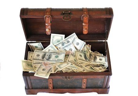 wooden ancient chest is full of thousand  of dollars isolated on a white background