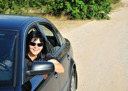 happy girl drive her car in the countryside,  she is happy, he smiling Stock Photo - 5338868