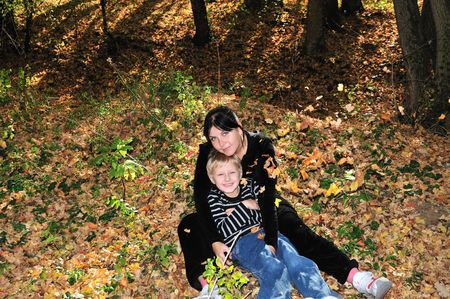 boy embracing his mother in the forest Stock Photo - 5832412