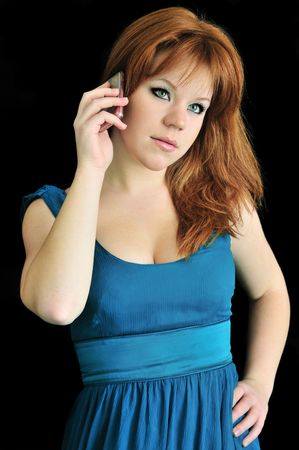 beautiful longhaired redheaded girl talking by phone photo