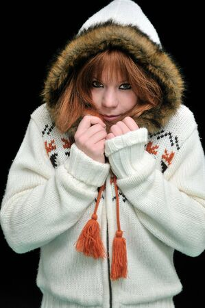 Portrait of beautiful girl wearing winter jacket. photo