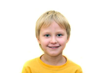 young boy smiling: little adorable young boy  smiling over white