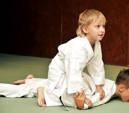 aikido boys are fighting for the competition