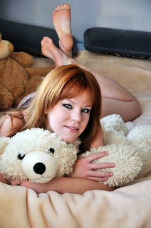 pretty redheaded girl laying on the bed Stock Photo - 6006333
