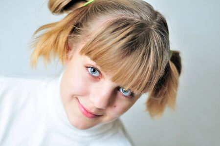 portait of pretty teen girl  with funny hairstyle photo