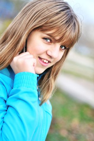 Beautiful teenager girl talking by cellular phone   Stock Photo