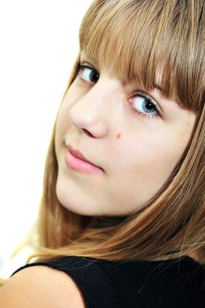 Closeup portrait of teen smiling girl, soft focus