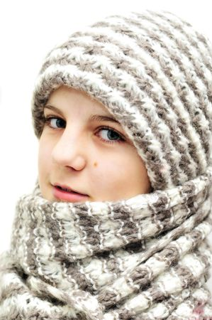 pretty teenage girl wearing wool hat and scarf over the white Stock Photo - 6091799