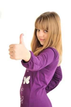teen girl showing thumbs up sign over the white background