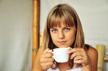 teen pretty girl with cup of coffee  photo