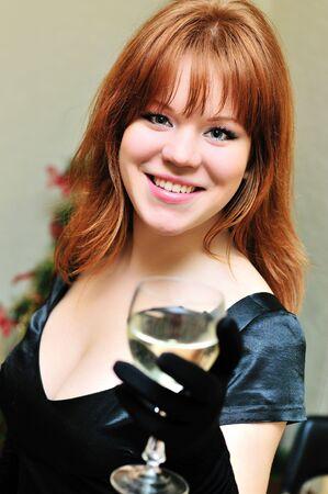 beautiful redheaded girl with glass of wine photo