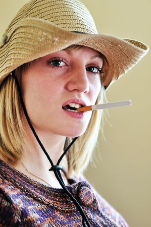 Beautiful Cowgirl with cigarette in her mouth  photo