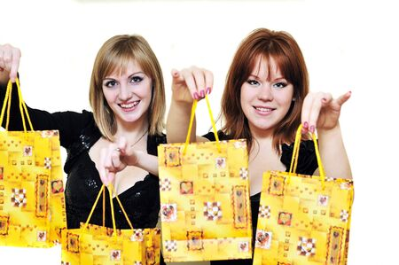 two happy girls with bags after shopping Stock Photo - 6289508