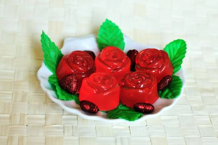 handmade beautiful red soap roses  on the plate Stock Photo - 6390090