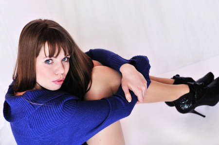 high heel shoes: longhaired girl in blue sweater and high heel shoes Stock Photo