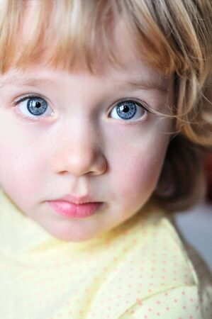 Portrait of lovely little girl with blue eyes Stock Photo - 6432807