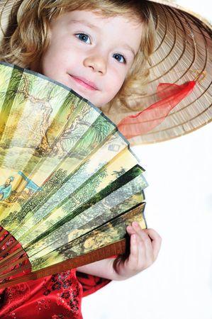mystique:  little girl with fan wearing like oriental girl  Stock Photo
