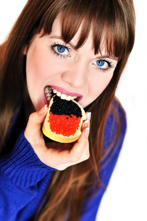 girl eating butterbrad with red and blach caviar 