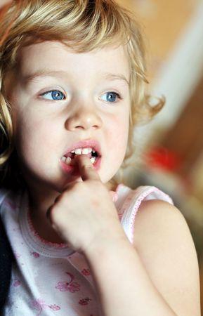 habit: bad habit for children - nail-biting Stock Photo