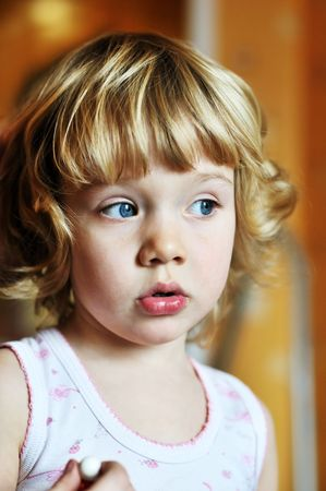 homelike: portrai of sweet little girl in homelike atmosphere