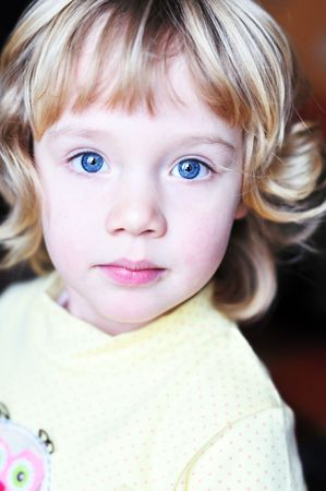 little blue-eyed pretty girl looking at the camera Stock Photo - 6617896