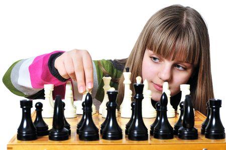 Young teen girl starting  set of chessmen - e2-e4  photo