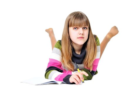 writing laying sweet teen girl over the white Stock Photo - 6617930