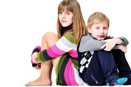 chuckle: brother and sister sitting on the white background Stock Photo