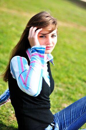 beautiful teen girl sitting on the grass Stock Photo - 6710930