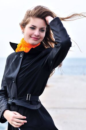 lovely teen girl in windy weather near the sea Stock Photo - 6711020
